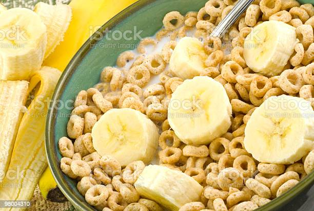Toasted Oat Cereal And Bananas Stock Photo - Download Image Now