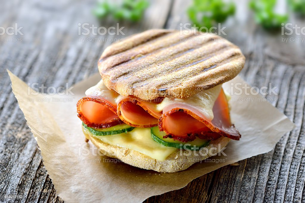 Toasted panini with ham and cheese stock photo