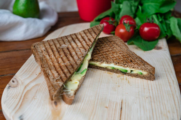 Toasted sandwich with avocado slice on plate stock photo