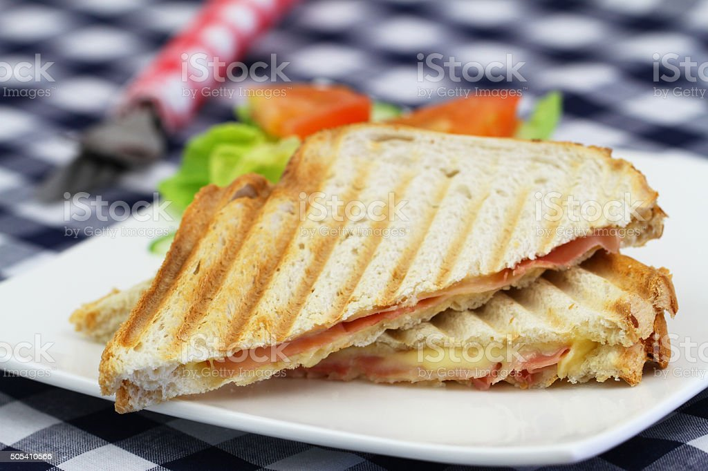 Toasted sandwich with ham an cheese and side salad stock photo