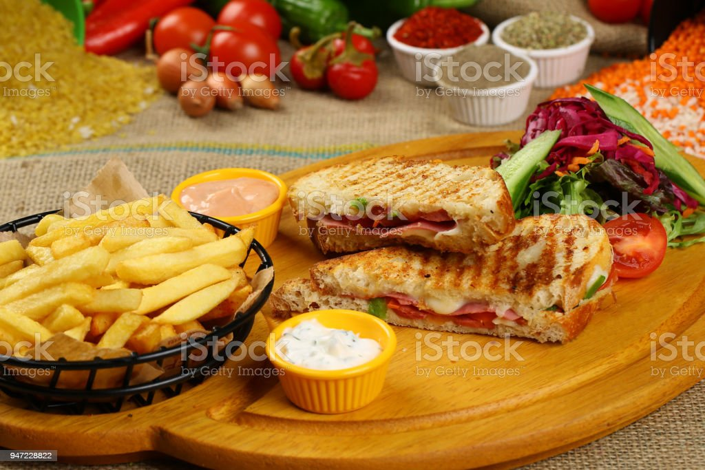 Toasted sandwich with ham and cheese stock photo