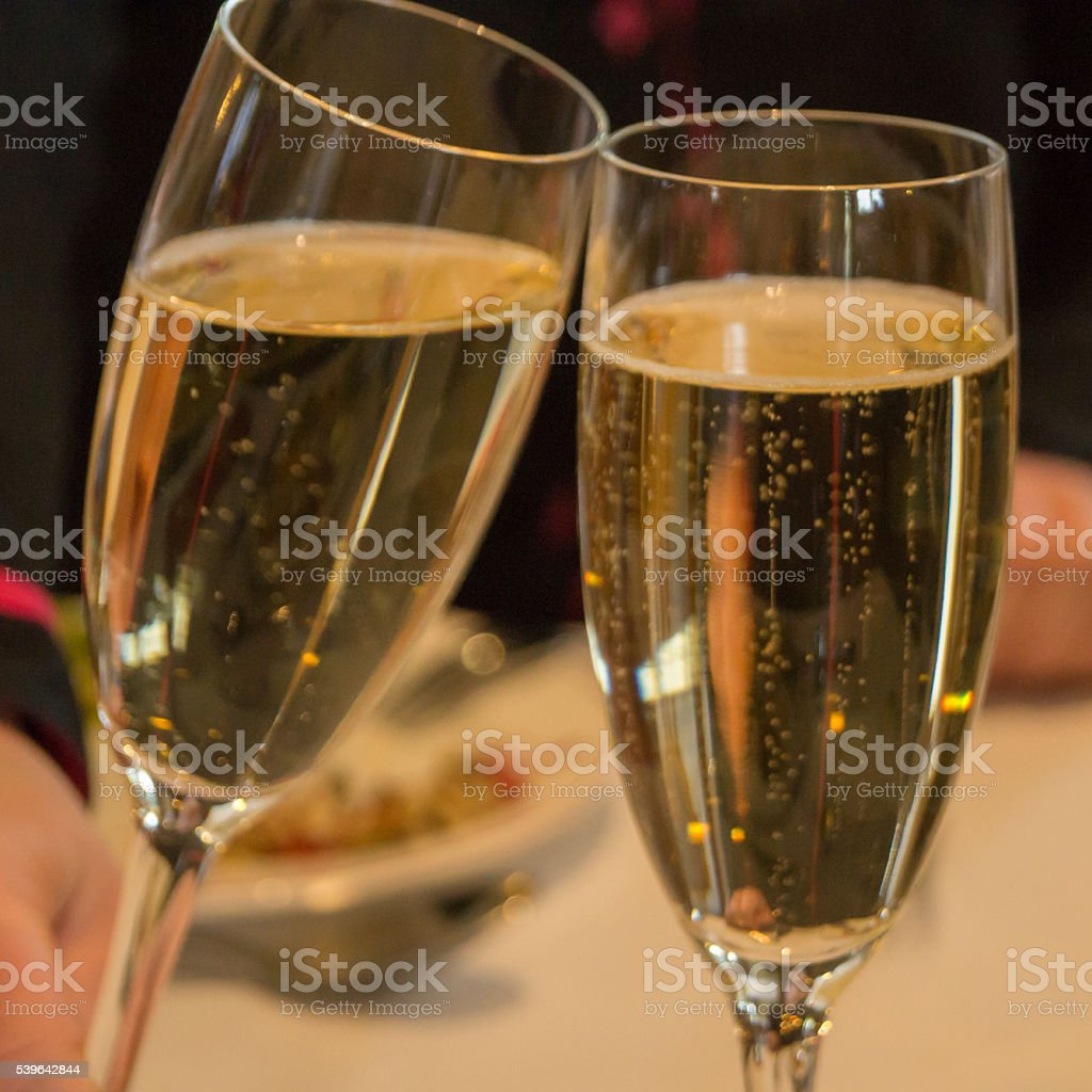 Toasting champagne glasses stock photo