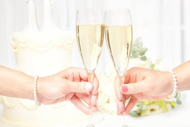 Toasting Champagne Same Sex Marriage Lesbian Wedding stock photo
