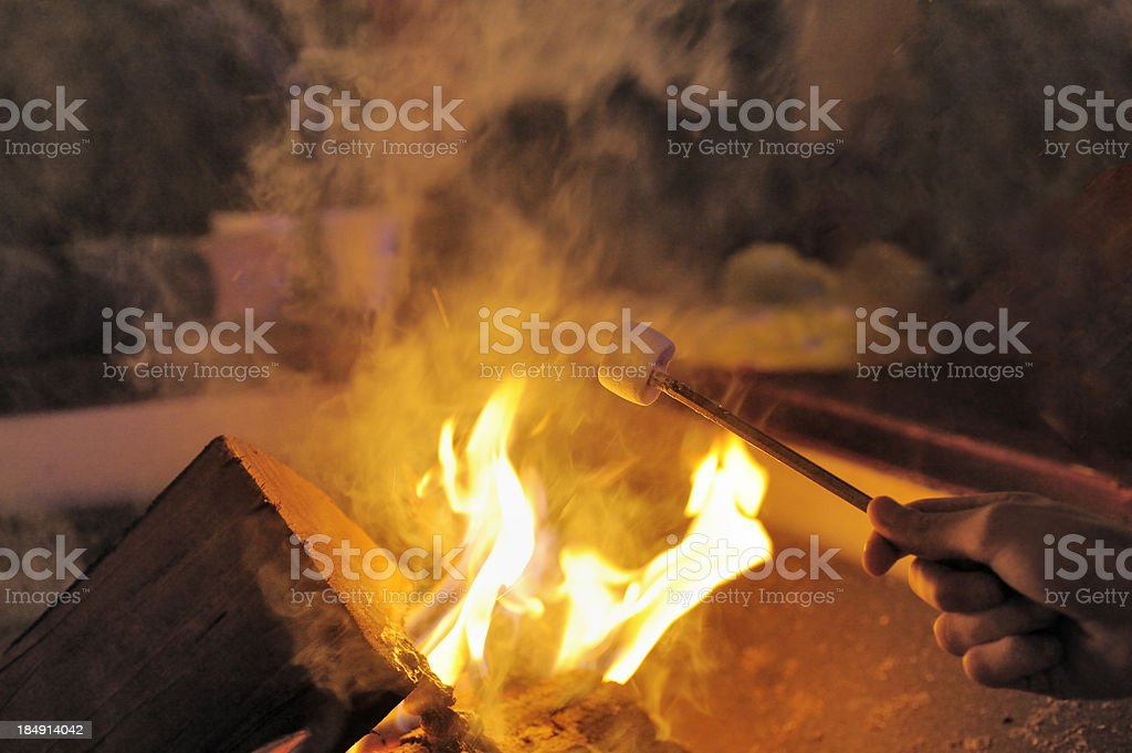 Toasting marshmallow on open fire royalty-free stock photo