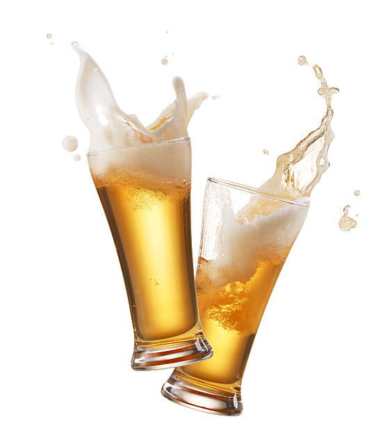 toasting two glasses of beer toasting creating splash beer glass stock pictures, royalty-free photos & images
