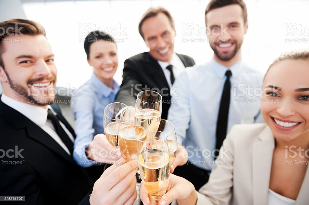 Toasting to success. stock photo