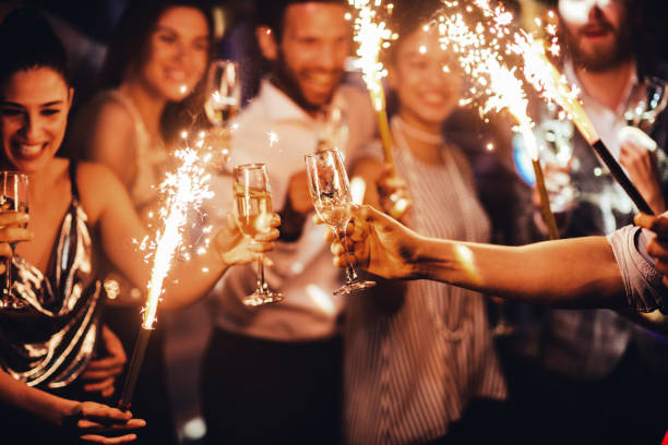toasting to this lovely night - holiday event stock pictures, royalty-free photos & images