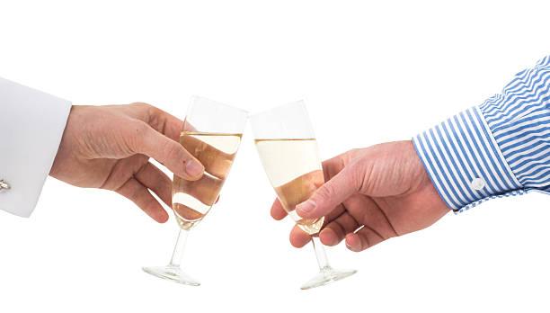 toasting zwei Hände stoßen an vor weißem Hintergrund two hand toasting with champagne z_wei stock pictures, royalty-free photos & images
