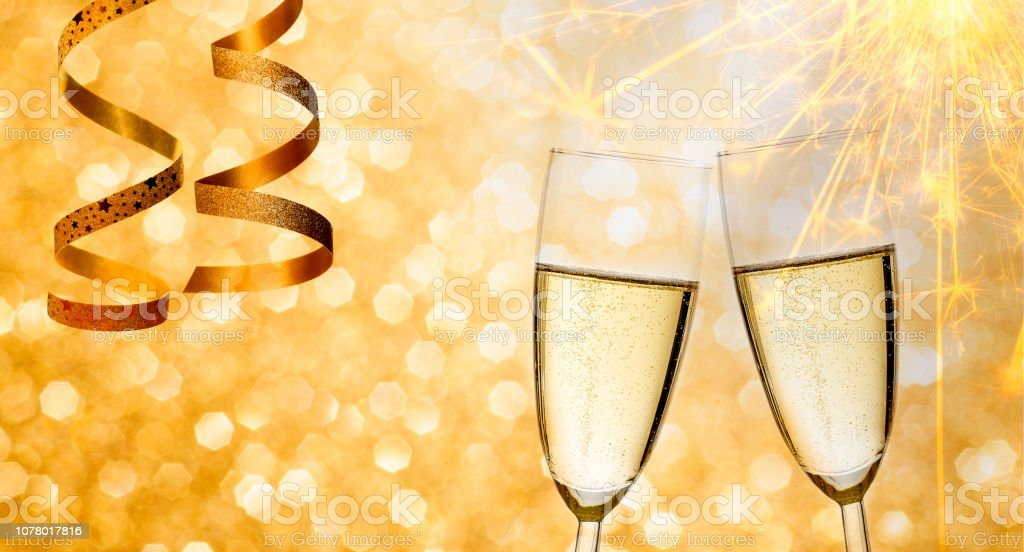 Champagne for the new year on gold romantic background with festive...