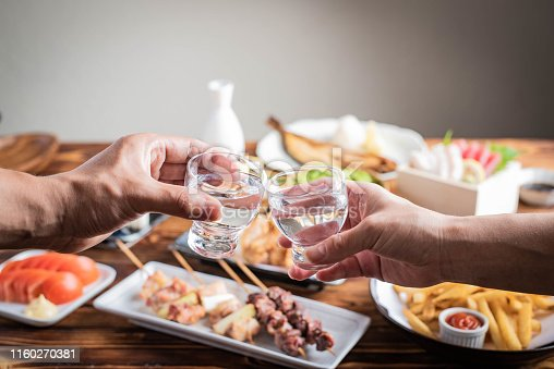 istock toasting with japanese sake and izakaya popular plates 1160270381