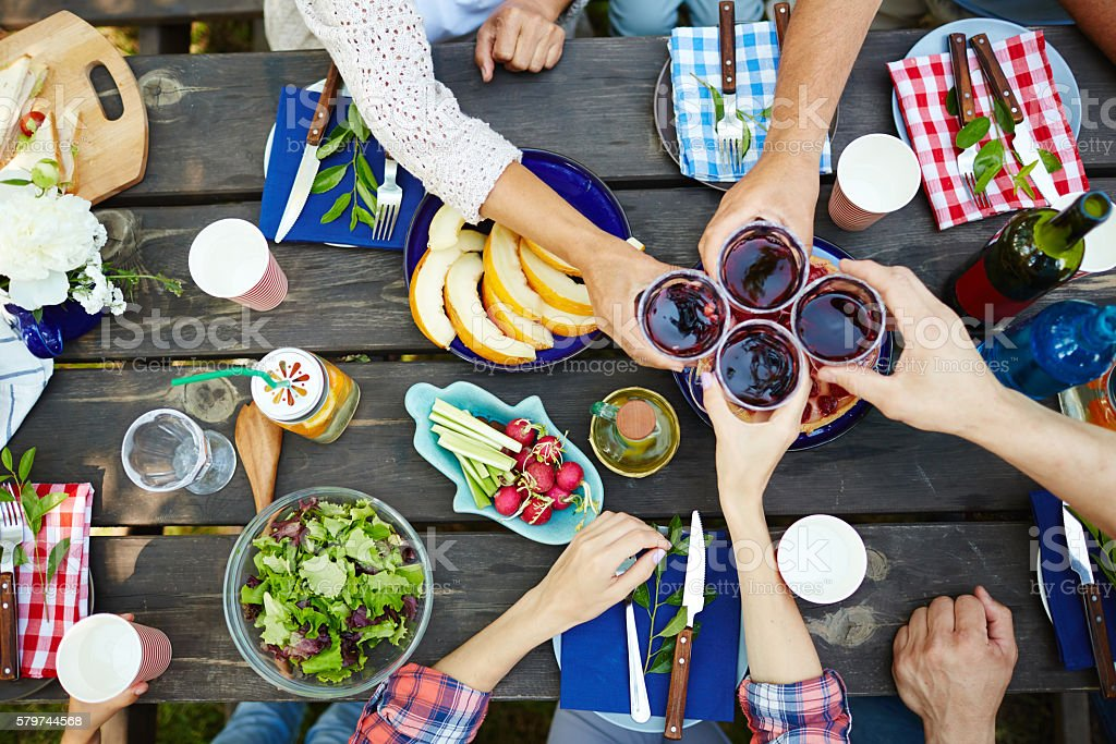 Toasting with red wine stock photo
