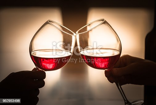 Couple toasting with red wine.