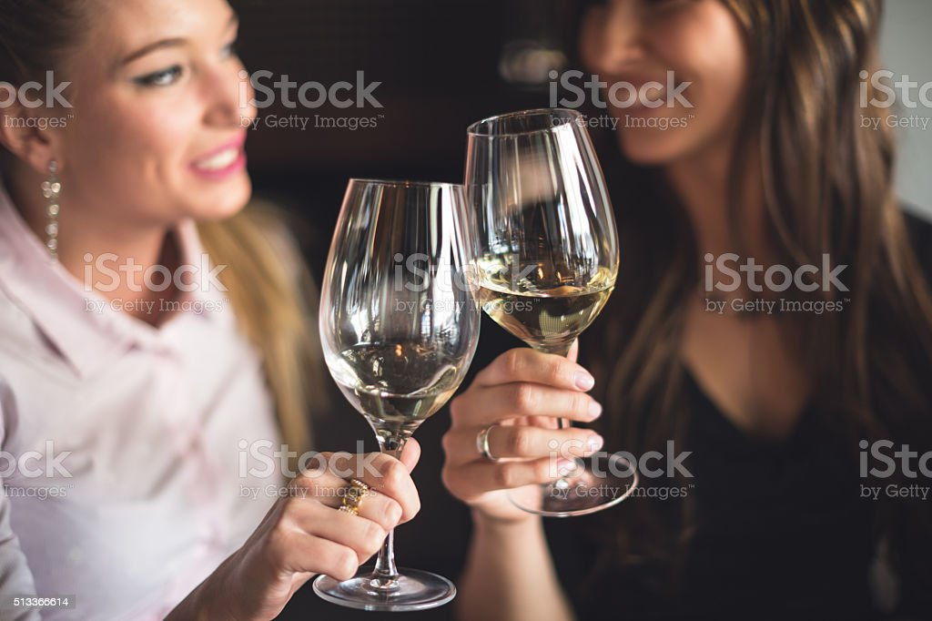 Toasting with white wine stock photo