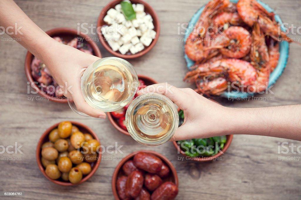 Toasting with wine on Spanish tapas stock photo