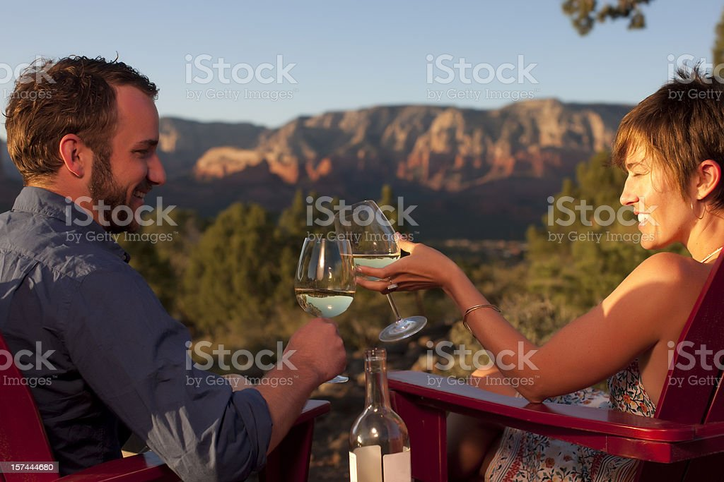 Toasting with wine outdoors stock photo