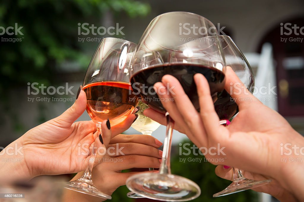 Toasting with wine. Group of unrecognizable people holding wine glasses and toasting. 20-29 Years Stock Photo