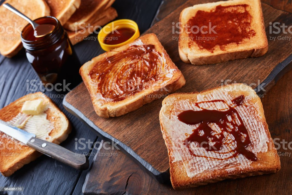 toasts for breakfast with butter and vegemite - Royalty-free Above Stock Photo
