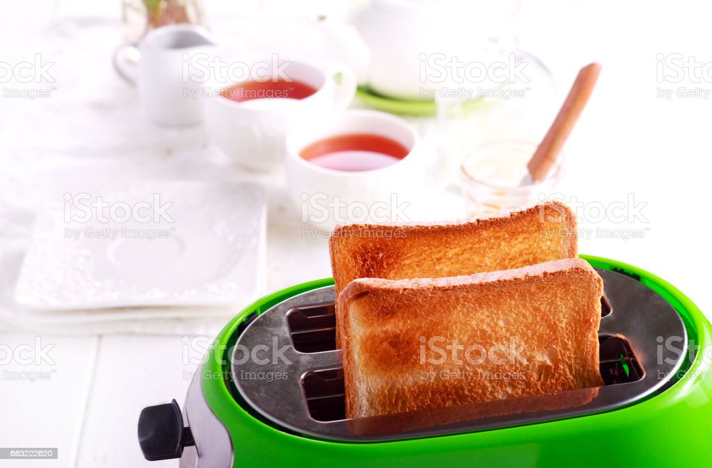 Toasts in a toaster, kitchen interior 免版稅 stock photo