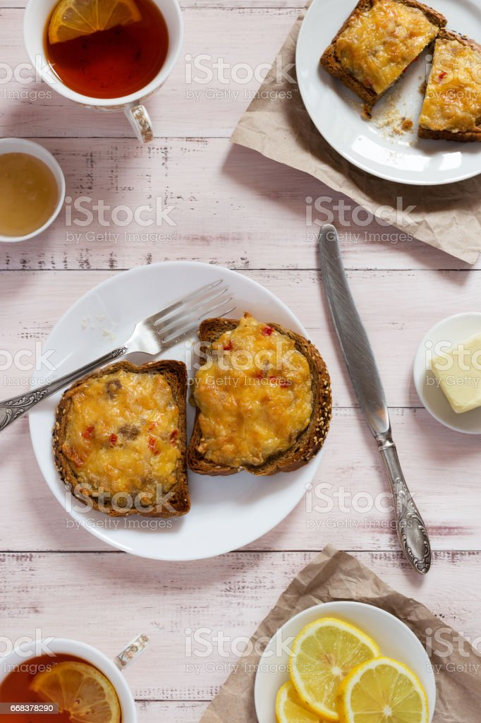 Toasts with cheese and lemon tea stock photo