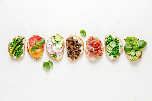 istock Toasts with whipped goat cheese and various topping 1144537543