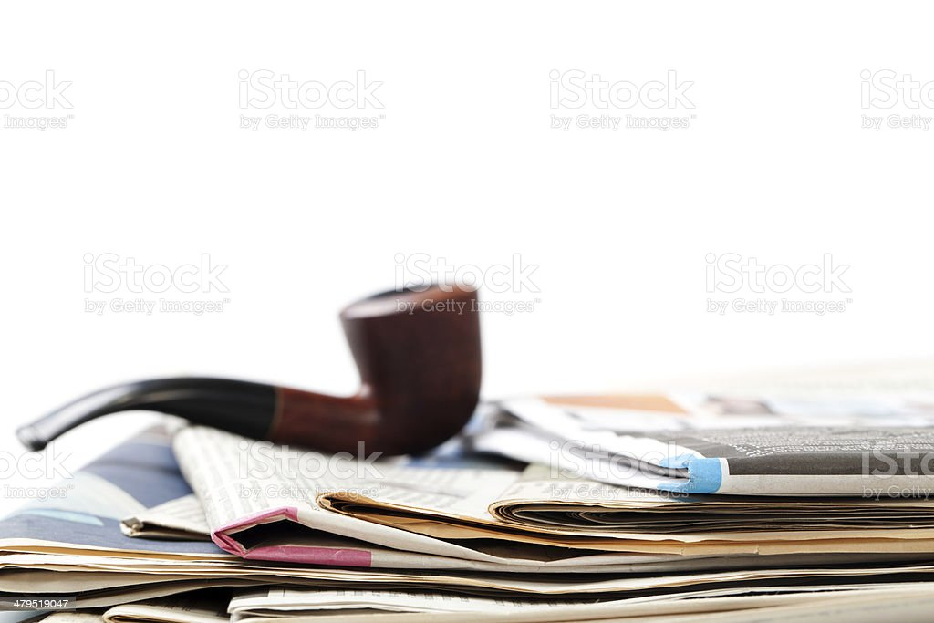 Tobacco Pipe and Newspaper royalty-free stock photo