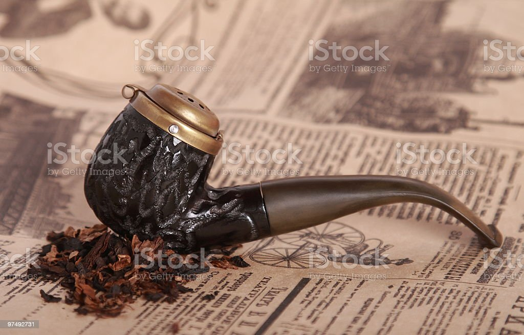 Tobacco pipe on old paper royalty-free stock photo