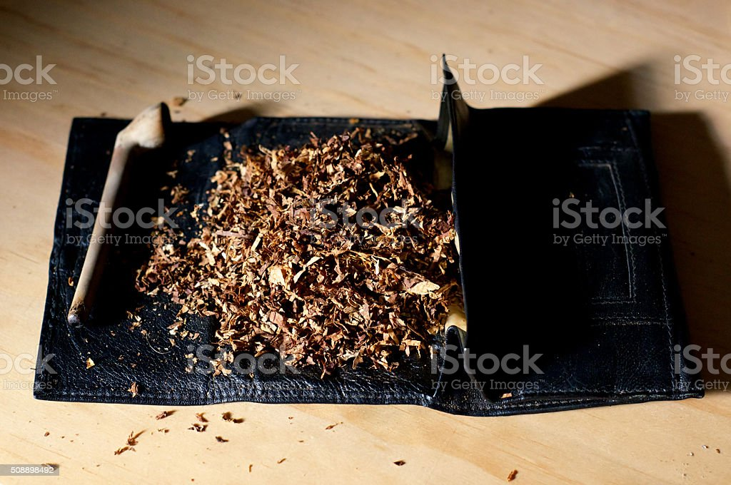 tobacco pouch and pipe stock photo