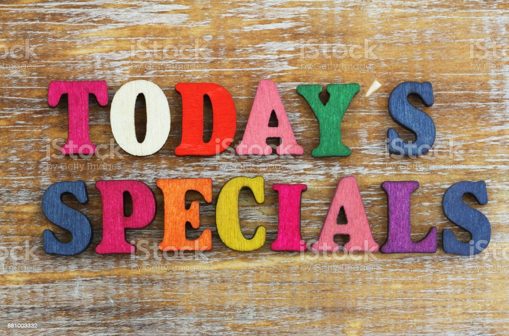 Today's specials written with colorful letters on rustic wooden surface stock photo