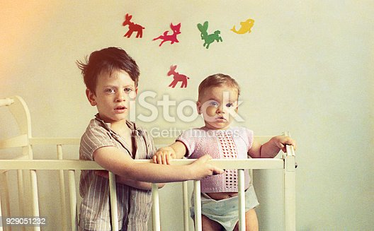 vintage color image of a cute brother and sister in the morning.