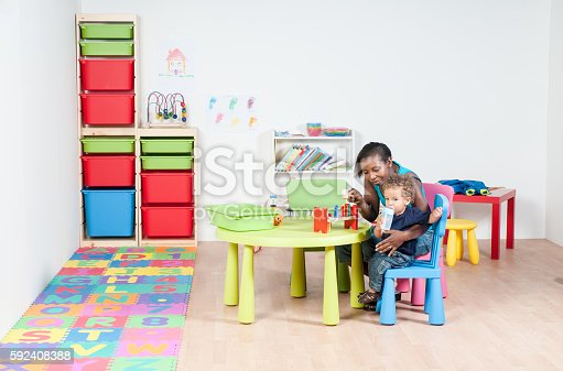 istock Toddler and Carer in the Nursery 592408388