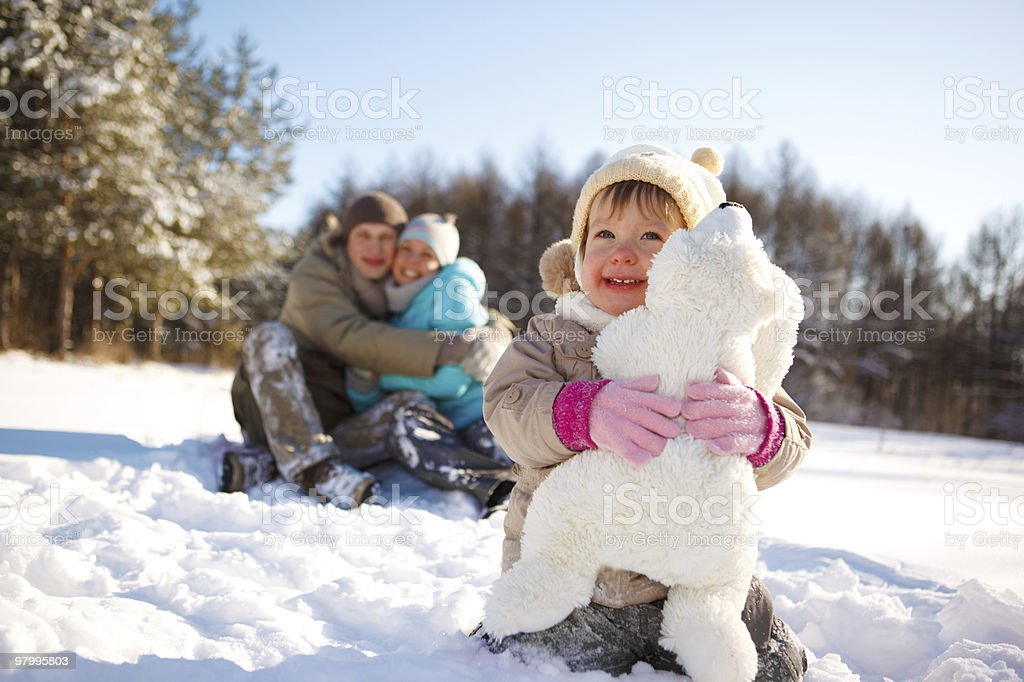 Toddler and her parents royalty-free stock photo