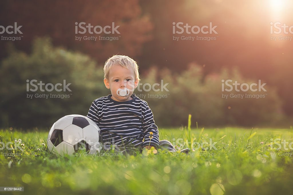 Toddler and the ball stock photo