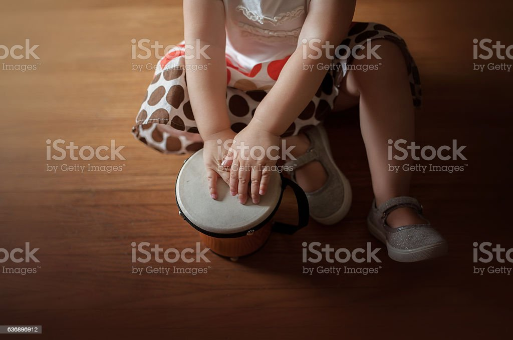 Toddler and Toy Drum stock photo