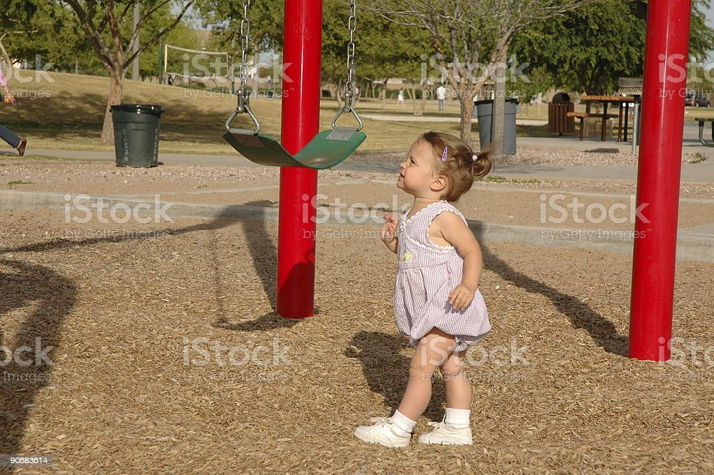 Toddler Approaches Swing royalty-free stock photo