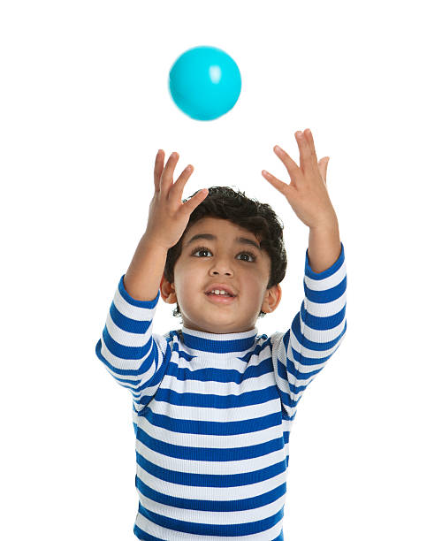 Toddler attempting to catch a Ball, Isolated, White stock photo