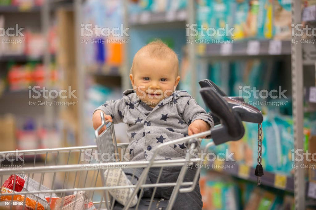 cdda271a8 Toddler Baby Boy Sitting In A Shopping Cart In Grocery Store Smiling ...