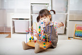 toddler baby girl play abacus toys at home