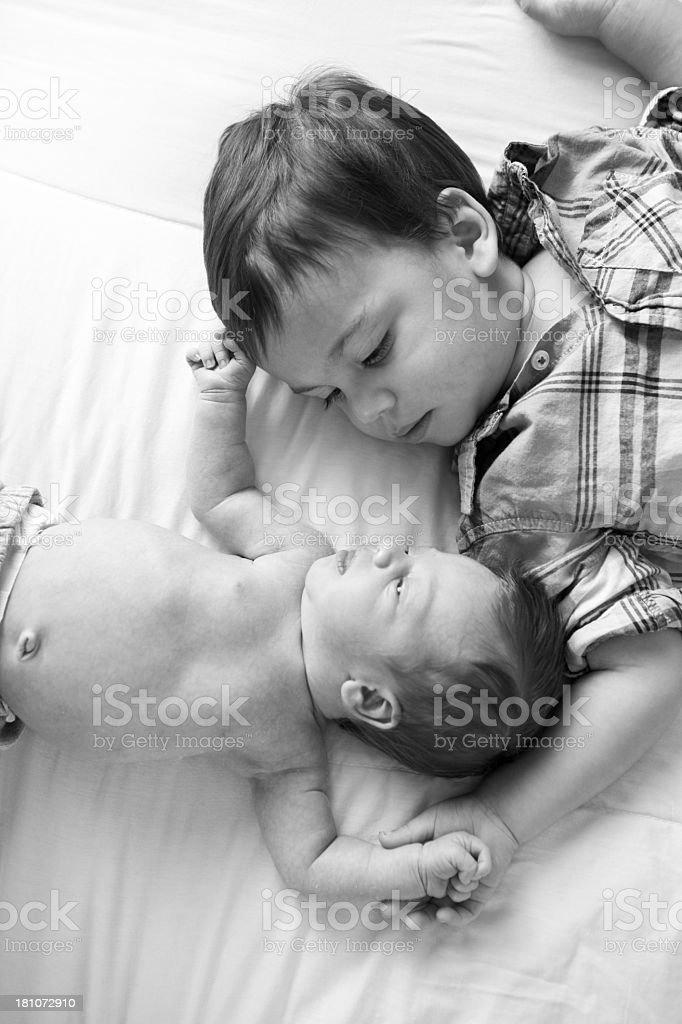 Toddler Boy and Baby Brother Looking at Each Other royalty-free stock photo