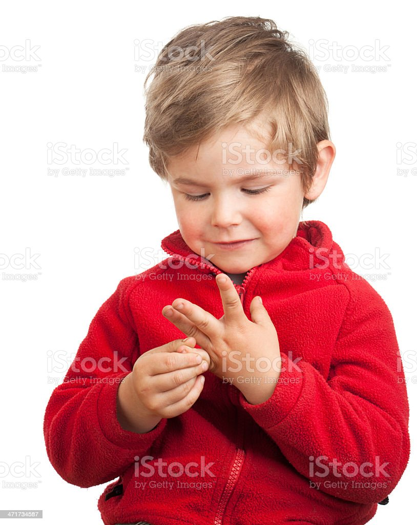 Toddler boy counting with fingers stock photo
