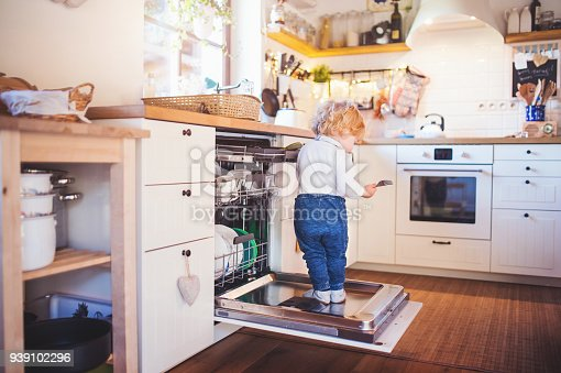 istock Toddler boy in dangerous situation at home. Child safety concept. 939102296