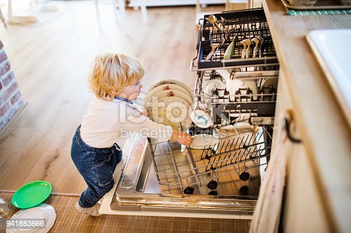 istock Toddler boy in dangerous situation at home. Child safety concept. 941883666
