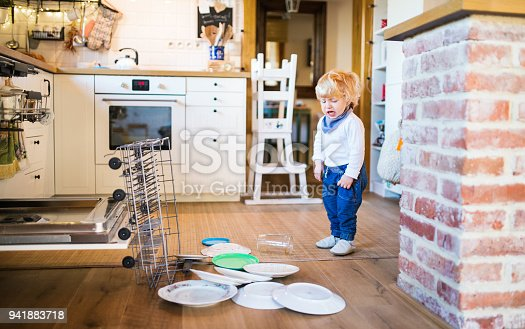istock Toddler boy in dangerous situation at home. Child safety concept. 941883718