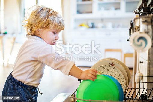 istock Toddler boy in dangerous situation at home. Child safety concept. 958464546