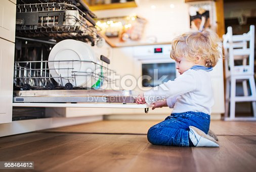 istock Toddler boy in dangerous situation at home. Child safety concept. 958464612