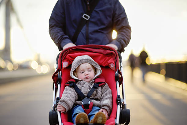 Toddler boy in stroller stock photo
