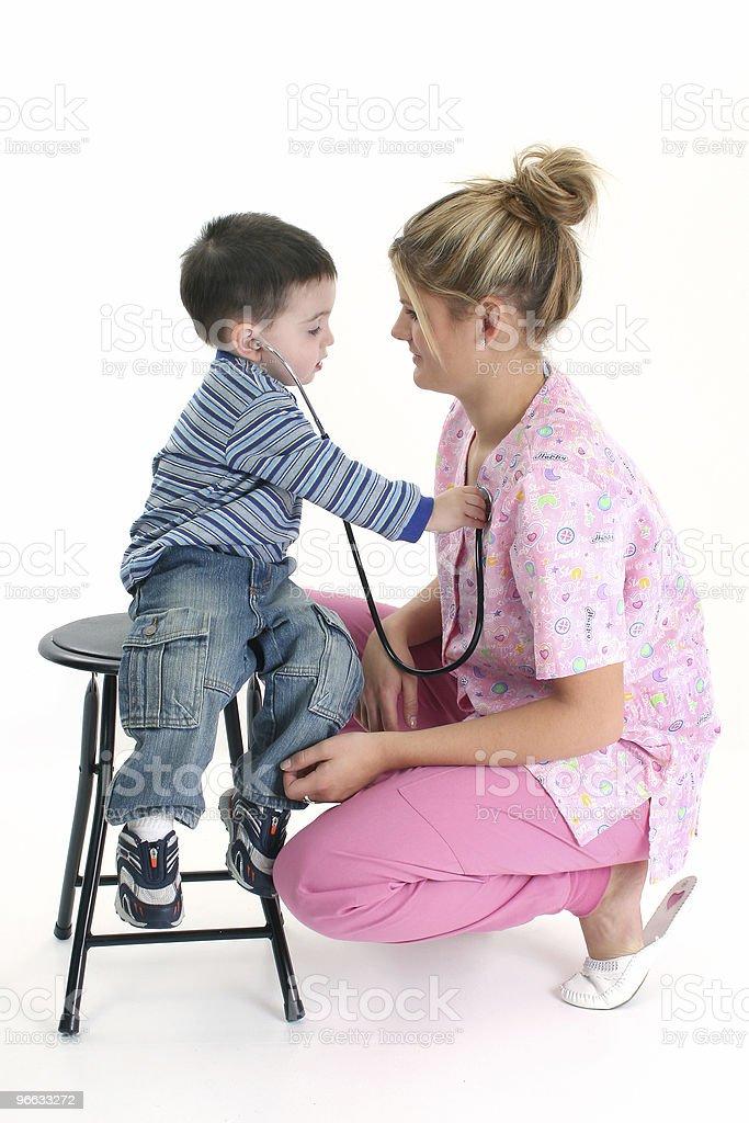 Toddler Boy Listening To Nurse's Heart royalty-free stock photo