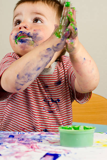 Toddler Boy Painting stock photo