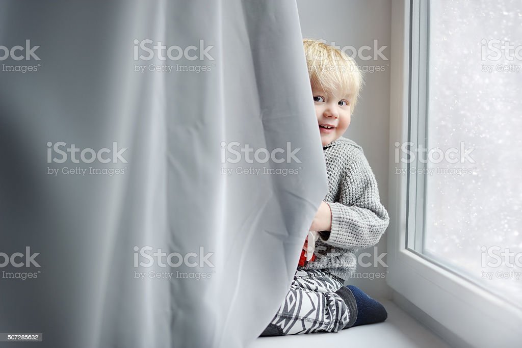 Toddler boy playing at home stock photo