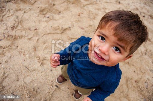 istock Toddler boy playing in sand 904536100