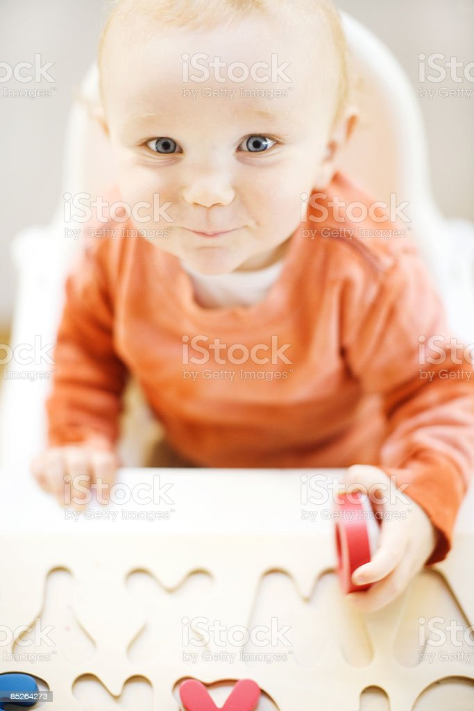 toddler boy playing with alphabet puzzle royalty-free stock photo